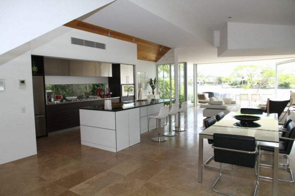 A picture showing a modern kitchen with glass worktops