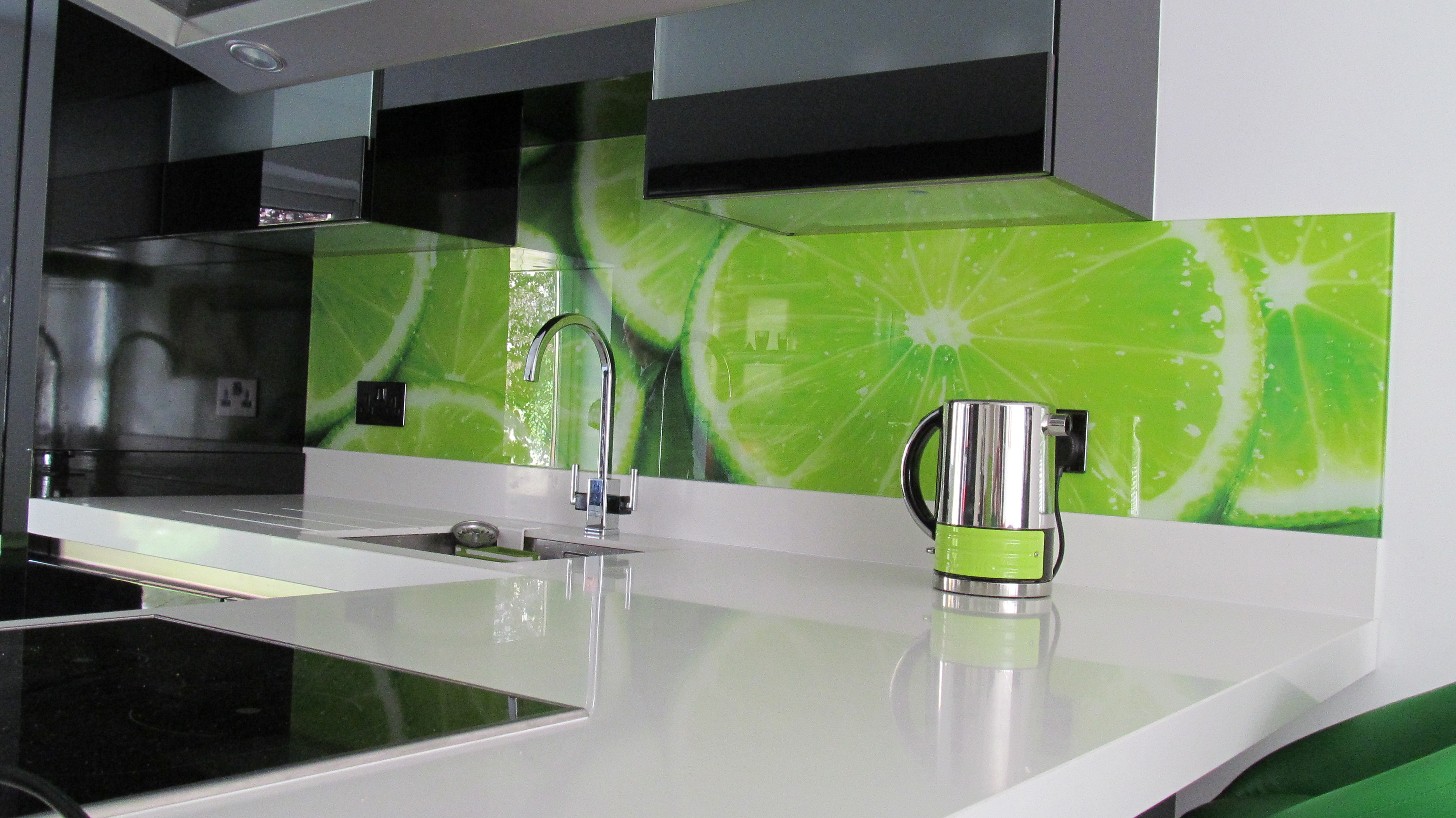 An image of a printed lime splashback, featuring an image of the fruit on the kitchen wall