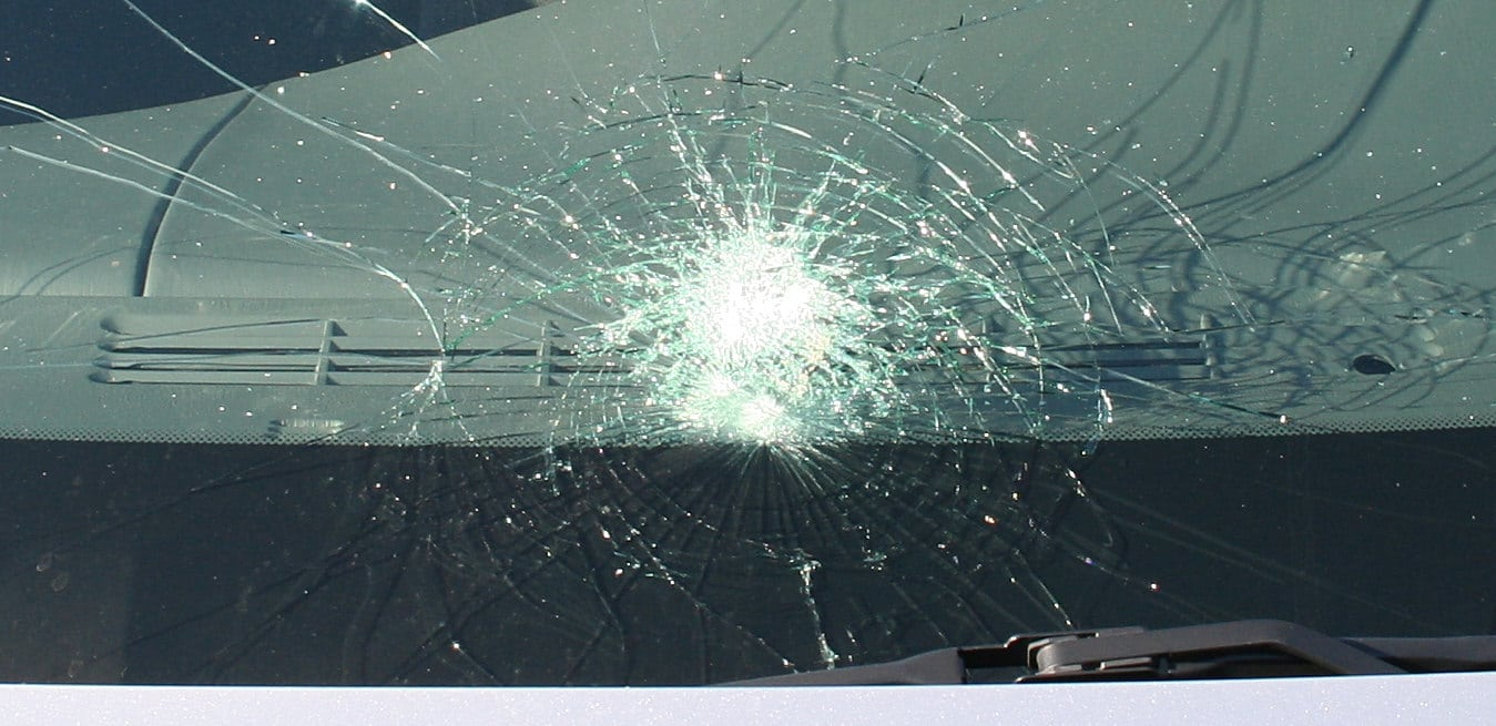 An image showing how laminated glass breaks, staying intact and not shattering