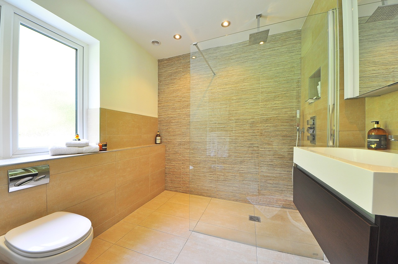 Image of a contemporary bathroom featuring a modern glass shower screen